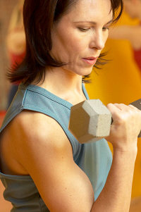 Resistance training may improve blood sugars ? Mature adult woman lifting ...